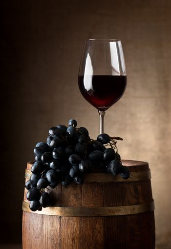Wineglass with wooden barrel
