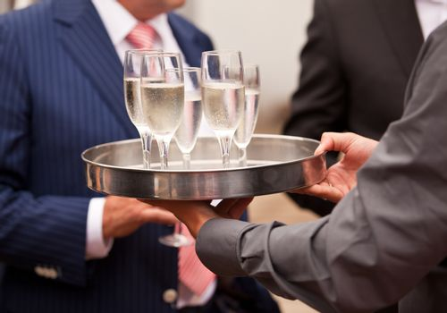 Waiter serving champagne at a party