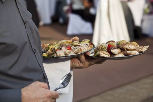 Waiter carrying plates of food