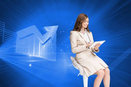 Composite image of happy brunette businesswoman using tablet