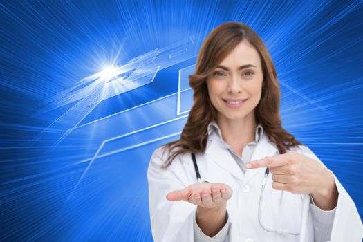 Composite image of smiling brunette doctor presenting her hand