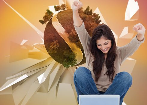 Composite image of pretty brunette cheering while using laptop