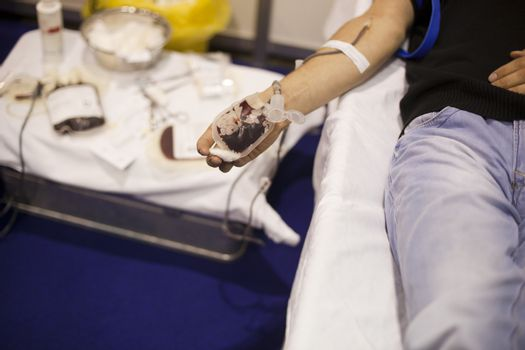 Blood donor's arm up close while giving blood