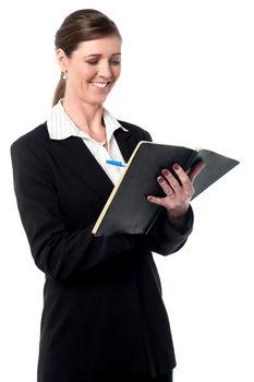 Corporate woman marking her schedule