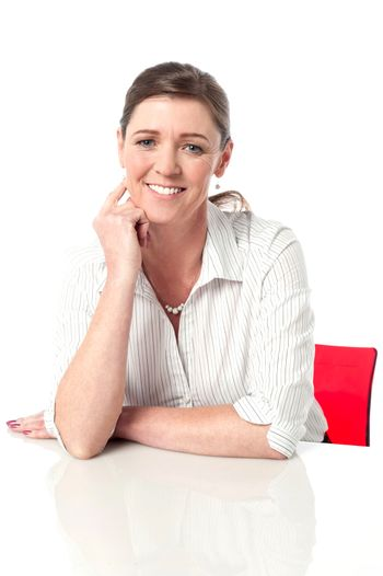 Calm corporate woman relaxing in office
