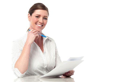 Female executive analyzing business reports