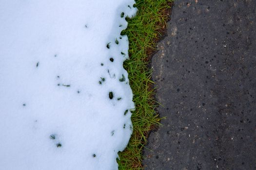 Snow in road with turf grass line texture detail