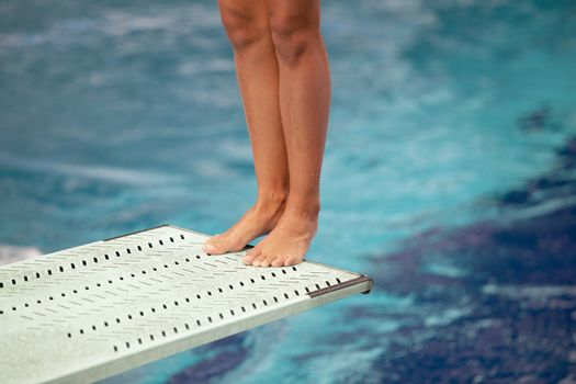 High diver jumping into the water