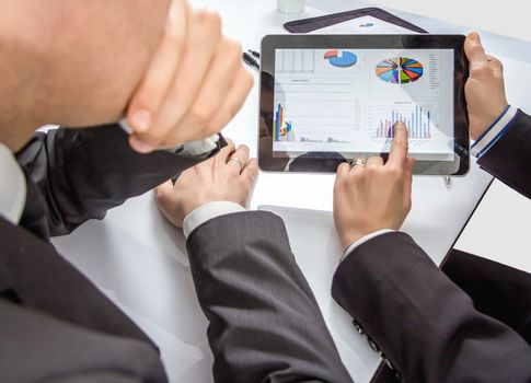 Business people analyzing financial charts and documents in a meeting for the success of company