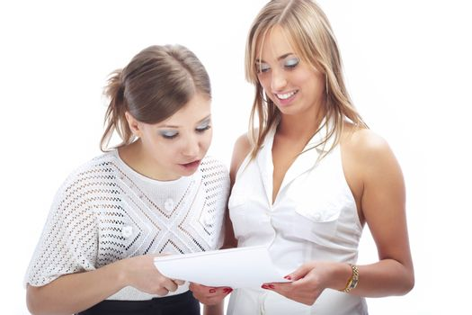 Two businesswomen reading the employment agreement