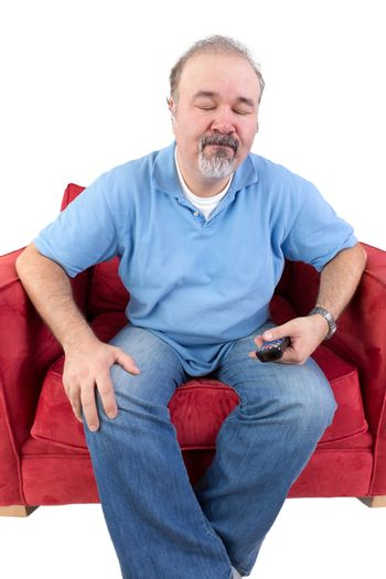 Man with a remote closing his eyes in resignation