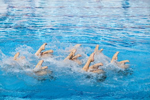 Synchronized swimmers legs movement