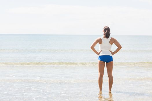Slender fit woman standing on the beach