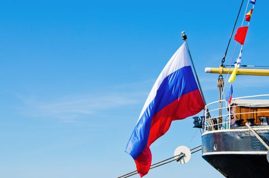 Russian flag flies at the stern old sailboat