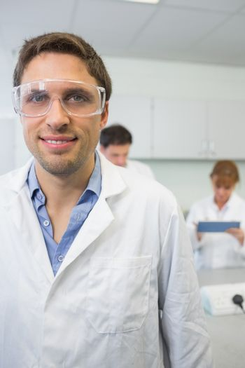 Scientist with colleagues at work in the lab