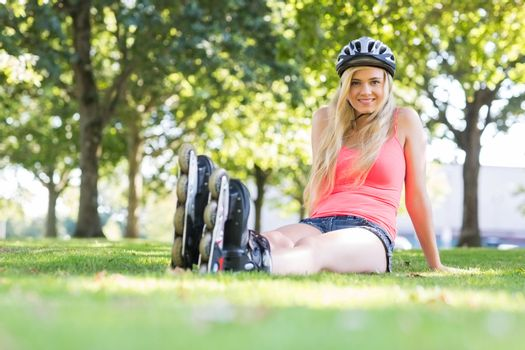 Casual happy blonde wearing roller blades