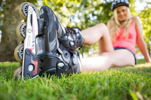Casual attractive blonde wearing roller blades