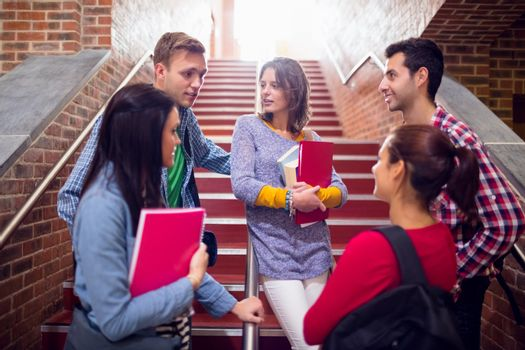 College students convering on stairs in college