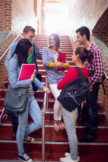 College students conversing on stairs in college