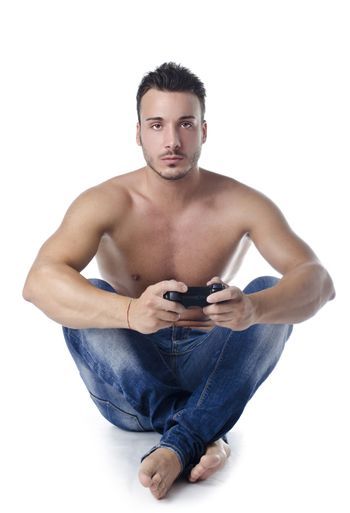 Handsome young man shirtless playing videogames with joypad