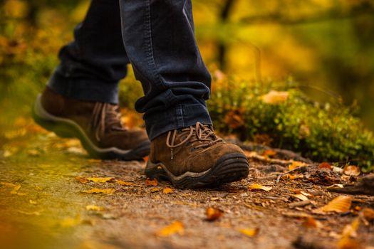 Close up of legs walking in narrow walkway