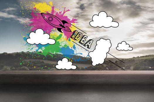 Rocket idea graphic over landscape background