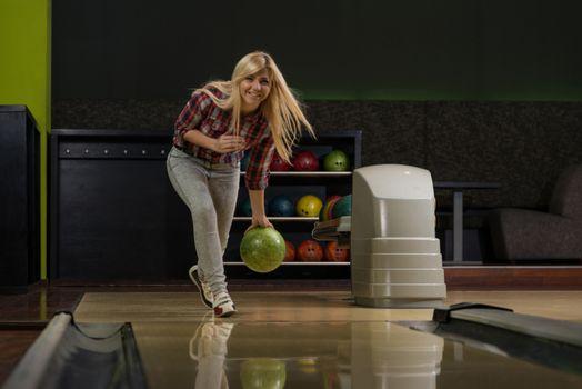 Young Women Bowling