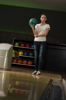 Women Holding A Bowling Ball