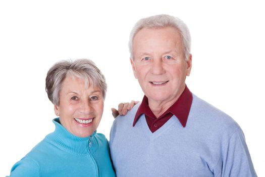 Portrait Of Happy Senior Couple Isolated Over White Background