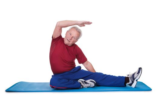 Portrait Of Senior Man Exercising On White Background