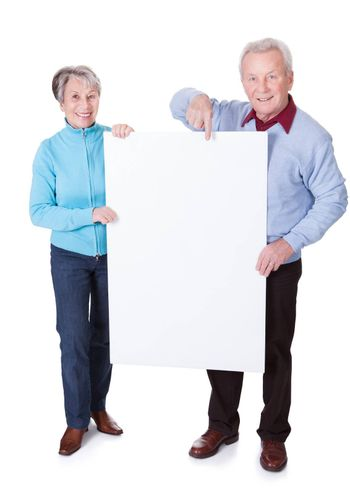 Happy Senior Couple Holding Blank Placard On White Background