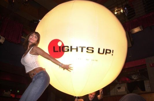 A model with the Lights Up light balloon at the Moviemaking Technology Showcase, featuring cutting edge movie technology, as well as two fashion shows, The Century Club, Century City, CA, 09-03-02