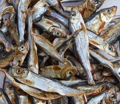 Plenty of small dried fishes on a stack