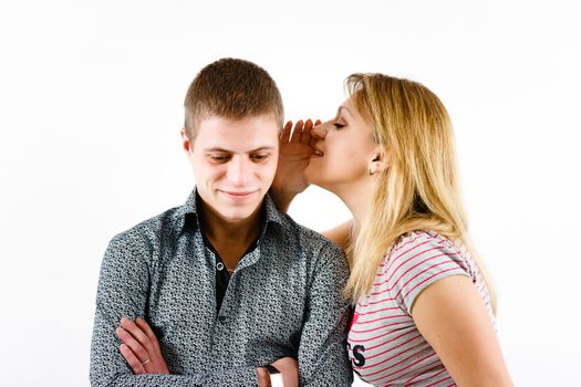 young woman whispering a secret
