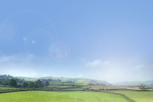 Rolling countryside background with blue sky.
