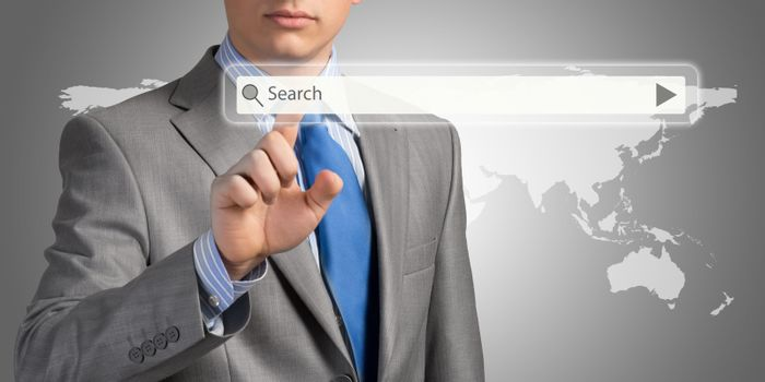 Businessman pushing on a touch screen, search for business information
