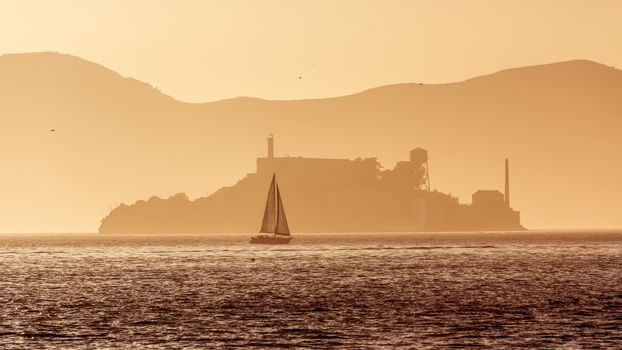 Alcatraz island penitentiary at sunset backlight in san Francisc