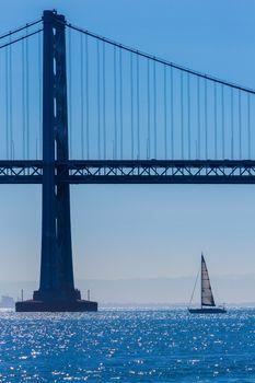 San Francisco Bay bridge sailboat from Pier 7 California