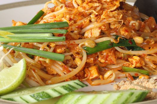 Close-up of Pad Thai fried rice noodles with shrimps and vegetables