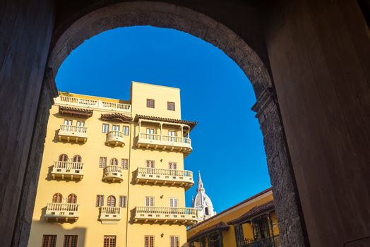 View of colonial balconies as seen from a high arching doorway in the historic center of Cartagena