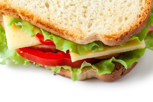 Single sandwich with fresh cheese, salad and meat isolated over white background