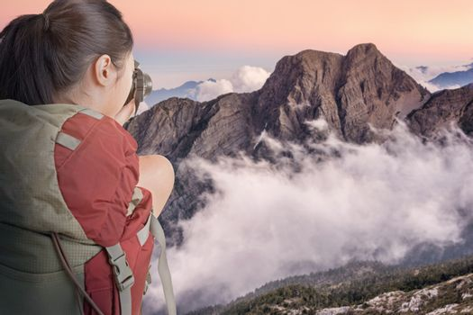 Young backpacker travel and take picture at Yushan National Park, Taiwan. The mountain was famous Yushan East Peak.