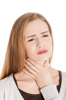 Beautiful casual woman is having sore throat.