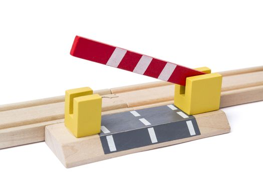 barrier is opening to give way over wooden railroad track