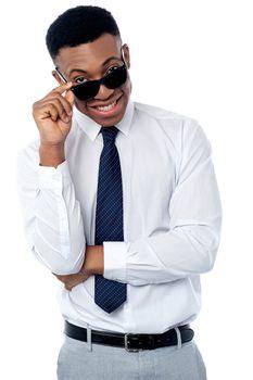 Businessman adjusting his sunglasses