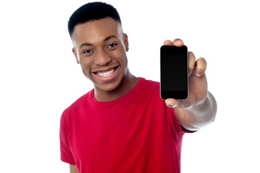 Young guy displaying brand new cellphone