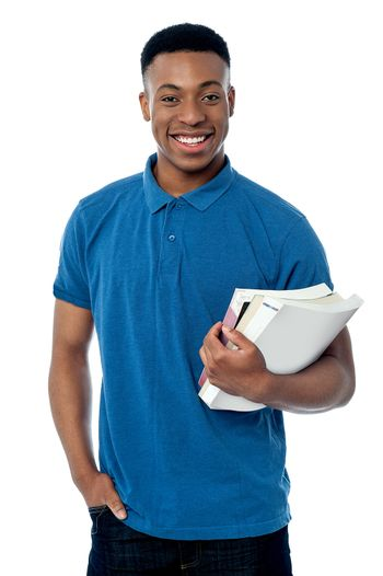 College student holding notebooks