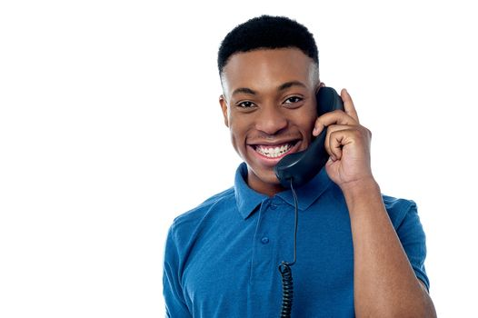 Young man attending phone call