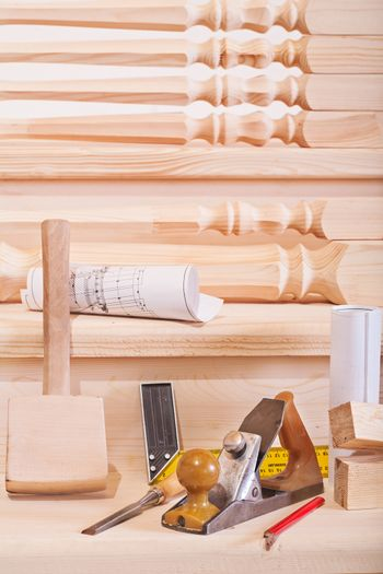 woodworking tools on steps of wooden lader