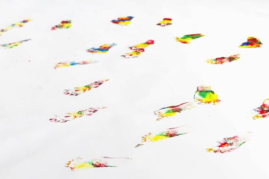many colorful footprints of small child on floor